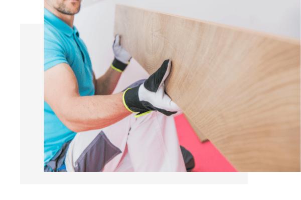 man installing solid timber flooring
